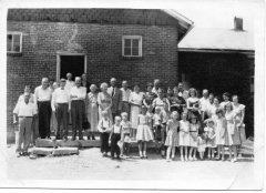 Pleasant Ridge Baptist Church congregation is shown in front of Bailey Switch school building ca. 1959