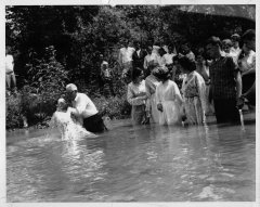 Rev. A.S. Marsee baptizes church members in Knox County.
